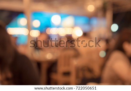 Coffee shop and people sit on table blur background with bokeh image .(vintage tone) #722050651