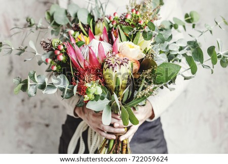 Woman Hands Holding Beautiful Flowers Bouquet #722059624