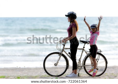 Mom and baby on bicycle  at beach side ,.relaxing concept . #722061364