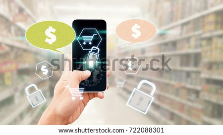 Cart icon from smart phone for shopping online concept : Hand press on shopping application with secure process in super market #722088301