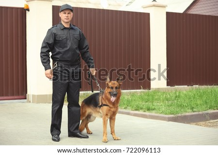 Security guard with dog, outdoors #722096113