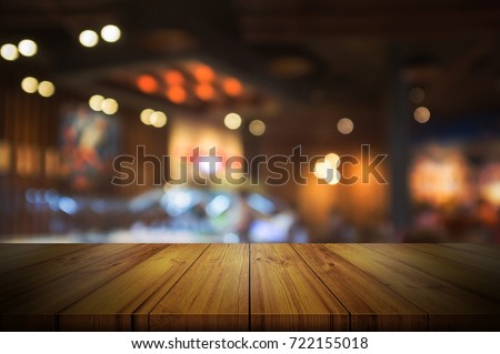 Empty wooden table top with blurred coffee shop interior background. can be used product display.  #722155018