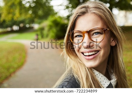 Portrait of beautiful smiling girl in glasses #722234899