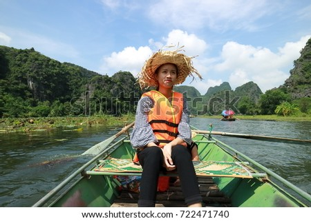 Young girl traveling to Tam Coc in Ninh Binh, Vietnam #722471740
