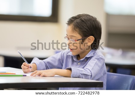 Portrait of boy learning at classroom together, Children with education concept. #722482978