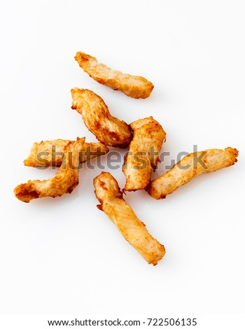 Fried chicken breast strips on white background #722506135