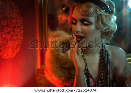 Retro portrait of a beautiful Gatsby woman. Vogue fashion style and smoke. Copy Space