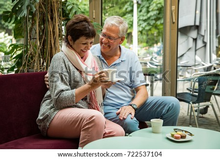 Senior couple in love sitting in cafe, drinking coffee, talking, laughing and having fun. Happy people in retirement concept. #722537104