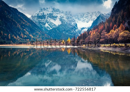 Dramatic autumn view of Braies Lake. Colorful morning scene of Italian Alps, Naturpark Fanes-Sennes-Prags, Dolomite, Italy, Europe. Beauty of nature concept background.  #722556817