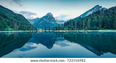 Great summer panorama of the Obersee lake. Green morning scene of Swiss Alps, Nafels village location, Switzerland, Europe. Beauty of nature concept background.