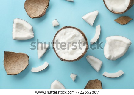 Composition with fresh coconut oil on color background #722652889