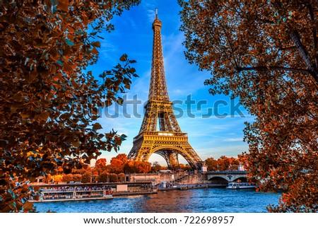 Paris Eiffel Tower and river Seine in Paris, France. Eiffel Tower is one of the most iconic landmarks of Paris. Autumn Paris.