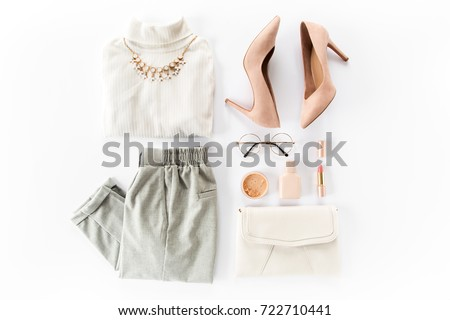 Woman clothes and accessories set on white background top view. modern and casual outfit. fashion, shopping and makeup concept. Flat lay, top view.  #722710441