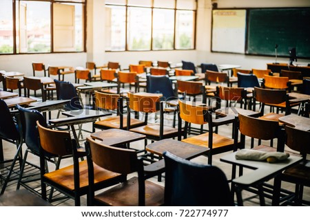 selective soft and blur focus.old wooden row lecture chairs in classroom in poor school.study room without student.concept for education