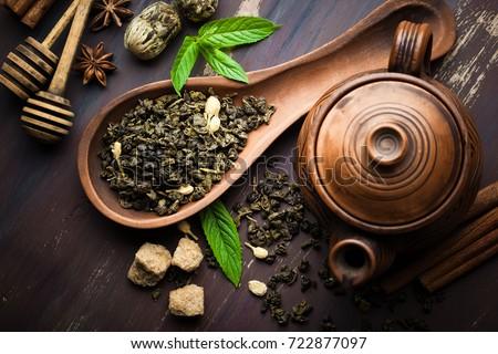 Dried tea leaves with tea pot #722877097