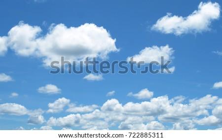 clouds in the blue sky #722885311
