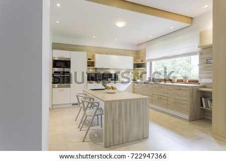 Kitchen in light colours and white furniture #722947366