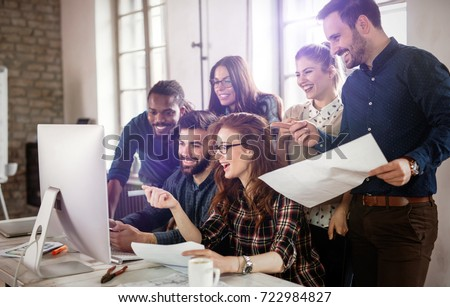 Company employees working in office #722984827