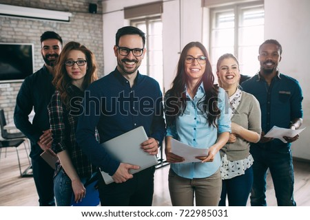 Successful company with happy workers Royalty-Free Stock Photo #722985031