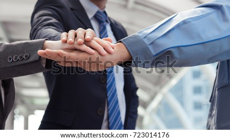 Group of young business people hands with stacking hands together expressing positive thinking, try positive action, teamwork concepts. #723014176
