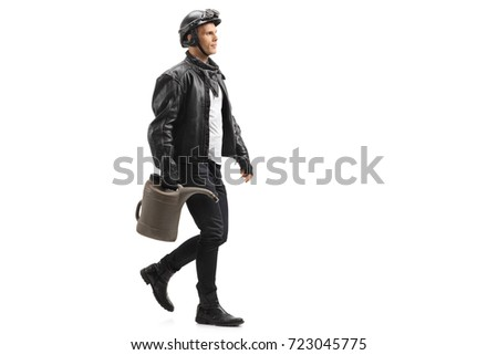 Full length profile shot of a biker with a gas container walking isolated on white background #723045775