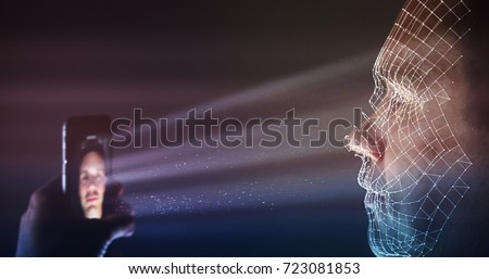 Unlocking latest smartphone with biometric facial identification Royalty-Free Stock Photo #723081853