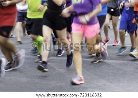 City runners ,blurred sport background #723116332