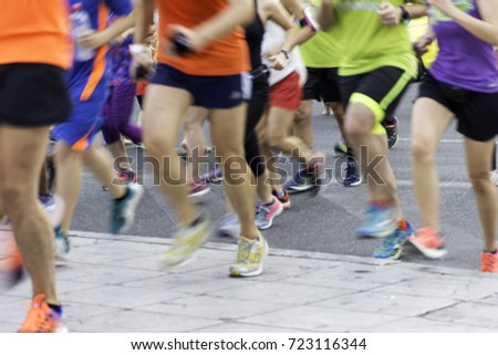 City runners ,blurred sport background #723116344