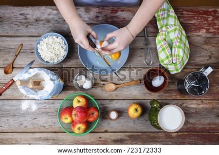 Cooking food. Woman cook breaks egg dough. #723172333