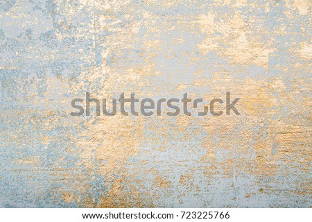 White and golden messy wall stucco texture background. Decorative wall paint. Royalty-Free Stock Photo #723225766
