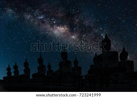 The milky way over Buddha to be used as background, Thailand. All buddha statue in Thailand is public domain. #723241999