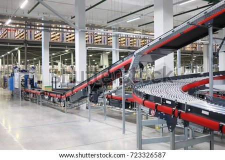 Big empty modern workshop with conveyors for sorting of goods Royalty-Free Stock Photo #723326587
