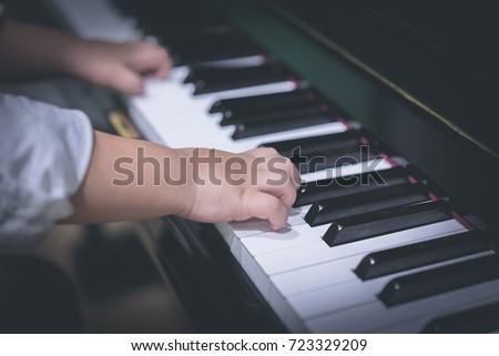 A boy is playing piano. #723329209