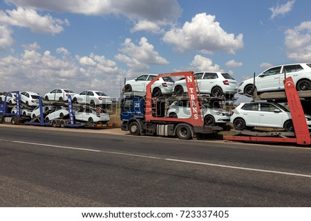 ODESSA, UKRAINE September 1, 2017: Car transporters carry cars. Transportation of car by specialized trucks. Special trailer for multi-tiered transportation of cars. Trailer transports cars #723337405