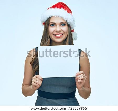 Smiling Santa girl business woman holding white blank advertising banner. isolated portrait. #723339955