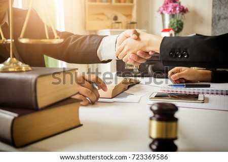 The hard work of an asian lawyer in a lawyer's office. Counseling and giving advice and prosecutions about the invasion of space between private and government officials to find a fair settlement. Royalty-Free Stock Photo #723369586