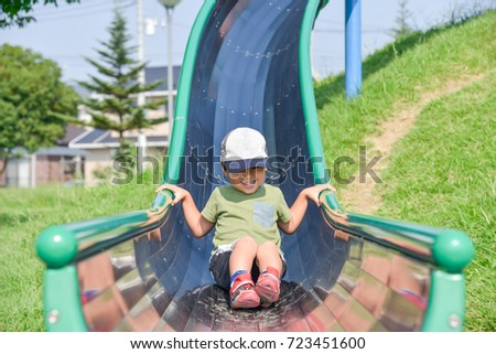 Boys playing on a slide #723451600