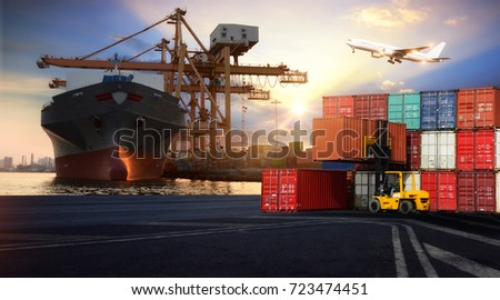 Logistics and transportation of Container Cargo ship and Cargo plane with working crane bridge in shipyard at twilight, logistic import export and transport industry background #723474451