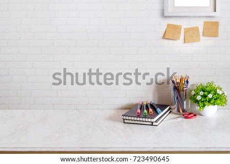 Contemporary desk Workplace with Supplies Concept. Desk space background. #723490645