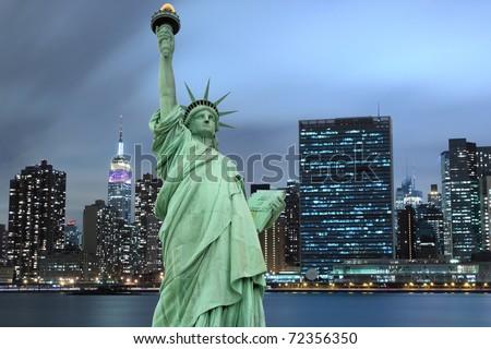 Manhattan Skyline and The Statue of Liberty at Night Lights, New York City #72356350