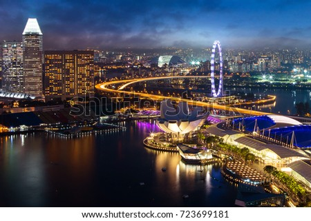 Singapore cityscape at dusk. Landscape of Singapore business building around Marina bay. Modern high building in business district area at twilight. #723699181