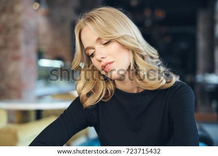 business woman in a cafe, lunch break                                #723715432