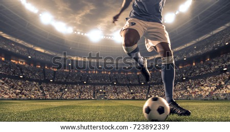 Soccer player kicks the ball on the soccer stadium. He wear unbranded sports clothes. Stadium and crowd made in 3D. #723892339