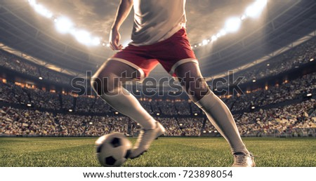 Soccer player kicks the ball on the soccer stadium. He wear unbranded sports clothes. Stadium and crowd made in 3D. #723898054