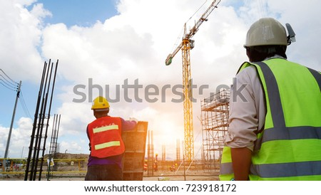 two engineer discussing a new project with large industry background #723918172