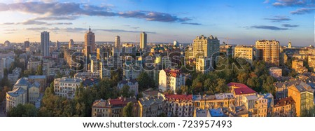 Beautiful area of kiev near the city center at sunset time, aerial photography in Kiev, Ukraine. Cycling track aerial view in Kiev, Ukraine #723957493