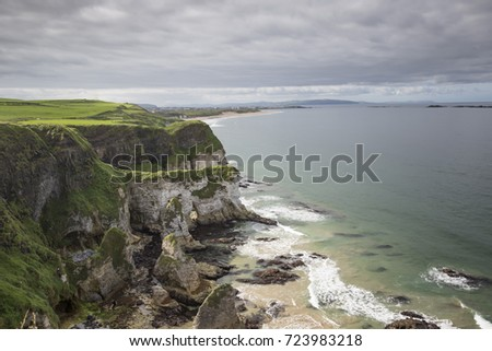 Dramatic clifftop view looking towards Portrush from the Antrim coastal route in Northern Ireland on a stormy day. #723983218