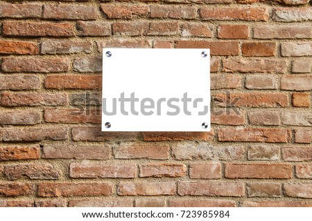 Empty information sign on old brick wall. White color