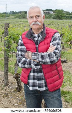 attentive elderly man outdoors in the wineyards #724056508