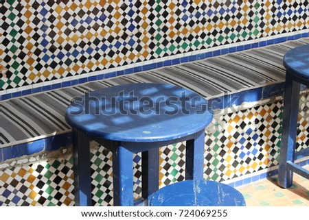 Typical mosaic pattern and blue chairs in a cafe in Rabat in Morocco #724069255